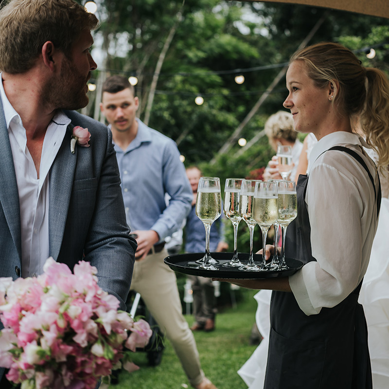 Champagne service at outdoor wedding